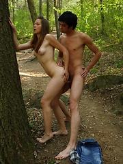 Teen girl outdoor sucking