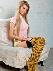 Horny girl in coloured stockings