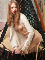 Marvelous long haired beauty stripping and showing her tantalizing pussy in the cradle.