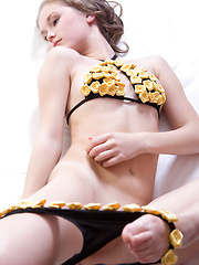 Caesaria raises the room temperature with a slow and sensual striptease of her skimpy black bikini with yellow miniature roses