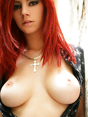 Ariel reveals her bouncy breasts and creamy skin while walking down a path.