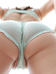 Holly plays with her ass while getting fucked hard