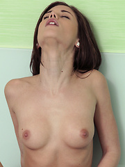 Brunette Caprice indulges in some wet and wild fun in the bathtub as she fondles her tits and fingers her juicy pussy