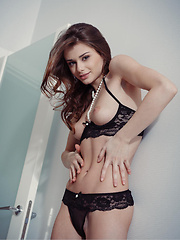 Loretta erotic striptease on the bed