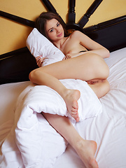 With a sweet smile of her angelic face, Loretta A shows her scrumptious body with delicate assets with playful, erotic poses.
