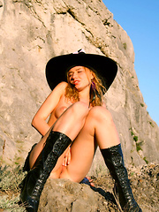 Black boots, a cute black dress and a sexy blonde babe is all it takes to make you go mad while viewing the images.