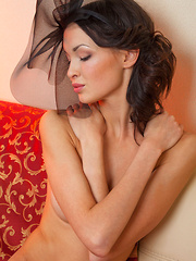 Xola exudes sultry elegance as she poses wearing nothing but a dainty mesh headgear. Along with her perfectly arched brows and pink kissable lips, she sprawls on top of the sofa and spreads her smooth, svelte legs, revealing a shaved, pink pussy.